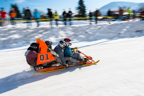Bobsled teams raced down Spokane Street at speeds nearing 50 mph.