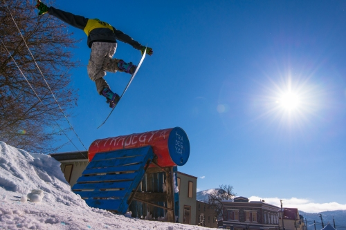 A snowboarder catches air--and some sun--at the Rail Jam.